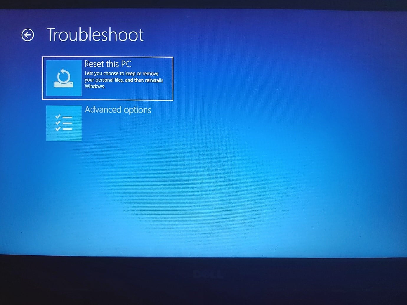 Select Reset this PC on the Troubleshoot page